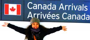 Canada Arrivals Gate girl with arms spread