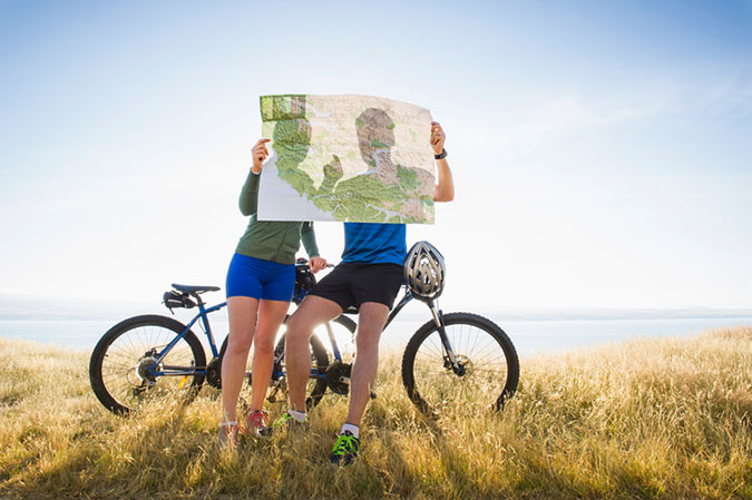 cyclists with a paper map