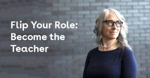 grey haired teacher against a brick wall - flip your role blog